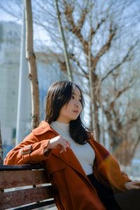 photo-of-woman-sitting-on-bench-3937899