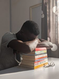 man-napping-on-books-3564013