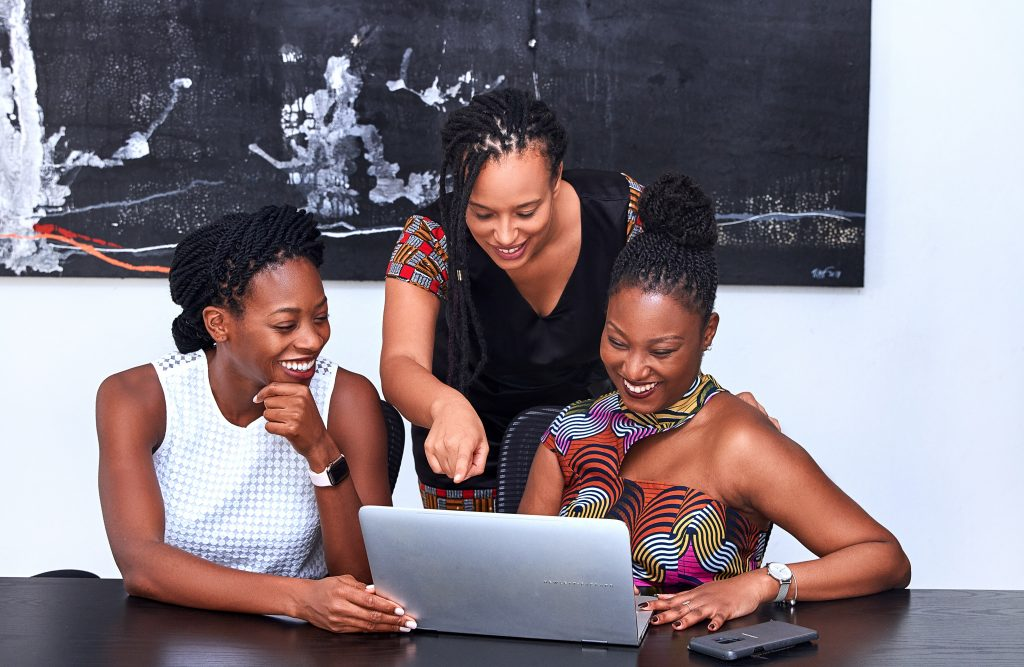 three-women-looking-at-the-computer-3894378
