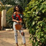 woman-wearing-ripped-jeans-3070508
