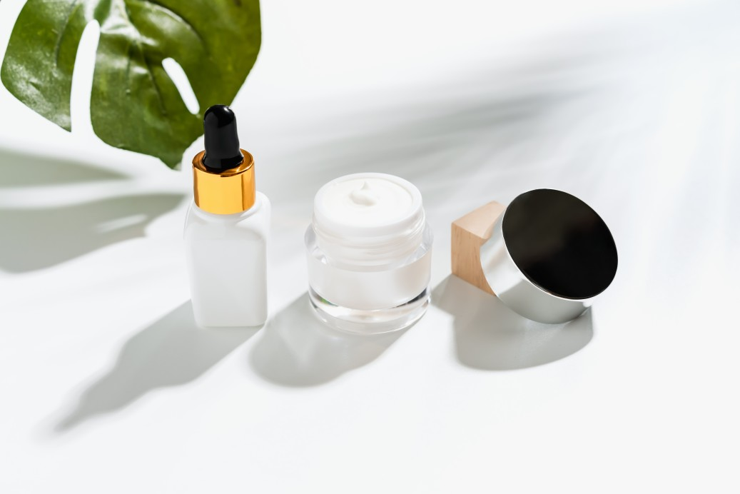 white-serum-bottle-and-cream-jar-mockup-of-beauty-product-brand-top-view-on-the-white-background_t20_lRoj9b (1)